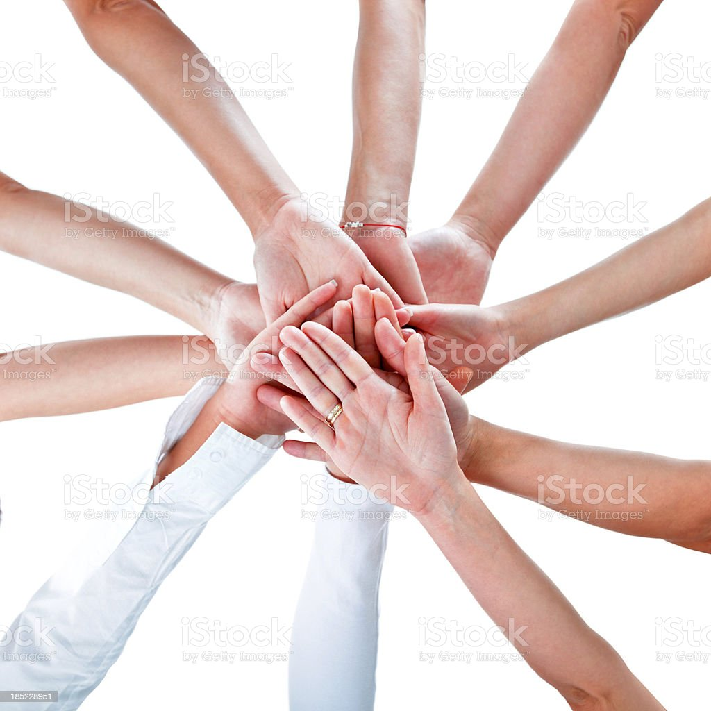 Solidarity Teamwork concept. 10 hands of women joining together. Elevated view, white background. Adult Stock Photo
