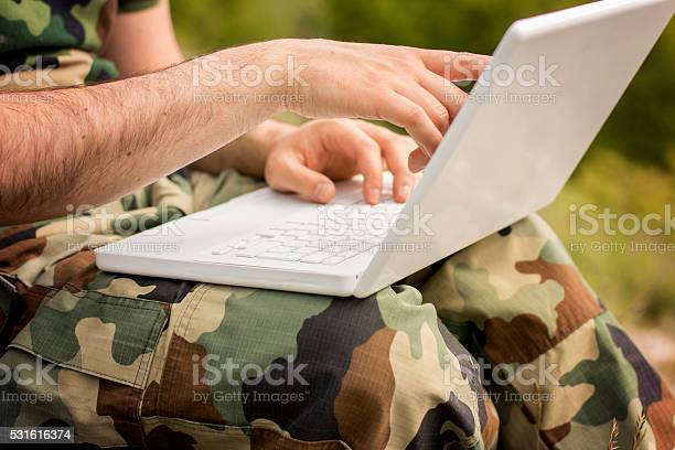Solider On Laptop Closeup Stock Photo - Download Image Now