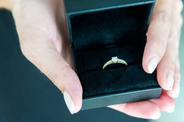 solitaire diamond ring in gift box - diamond ring hand stock photos and pictures