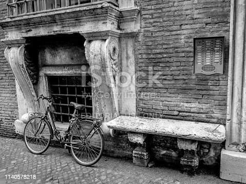 Rome, Italy, Feb 10 - Be a bicycle in Rome. A solitary bicycle rests near an ancient Renaissance palace, in Via Giulia, in the heart of the eternal city.