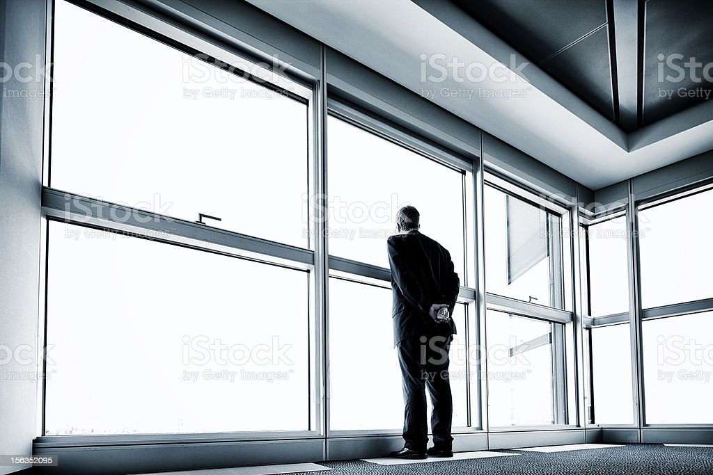 Solitary businessman stock photo
