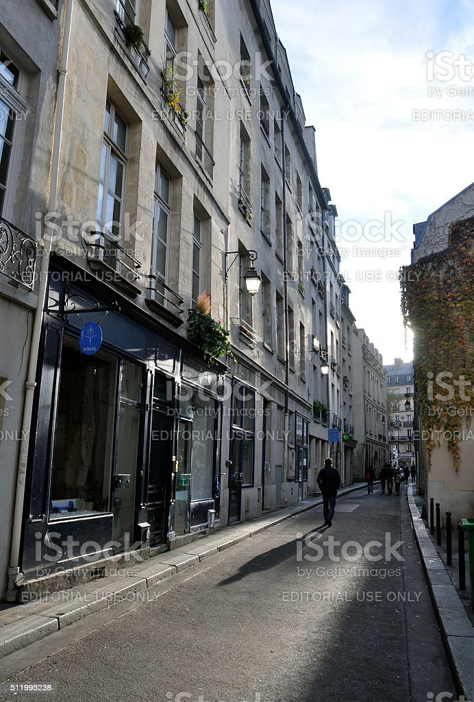 Solitary walker in Paris stock photo