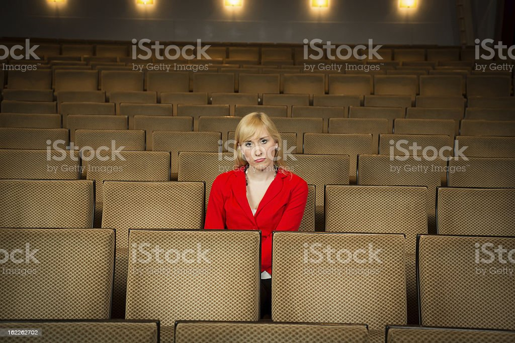 Solitary woman in a theatre stock photo