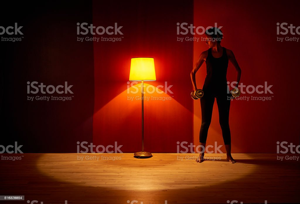 Model with hand weights sitting standing relaxed. Single electric...