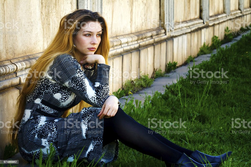 Solitude - sad pensive woman sitting alone royalty-free stock photo