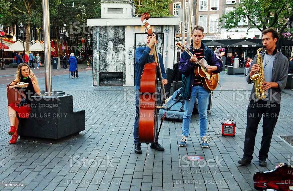 Solo Dinner with Street musicians. stock photo