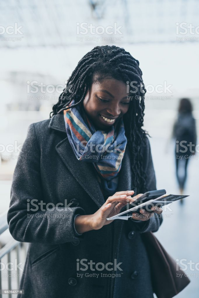Solo female traveler at aiport stock photo