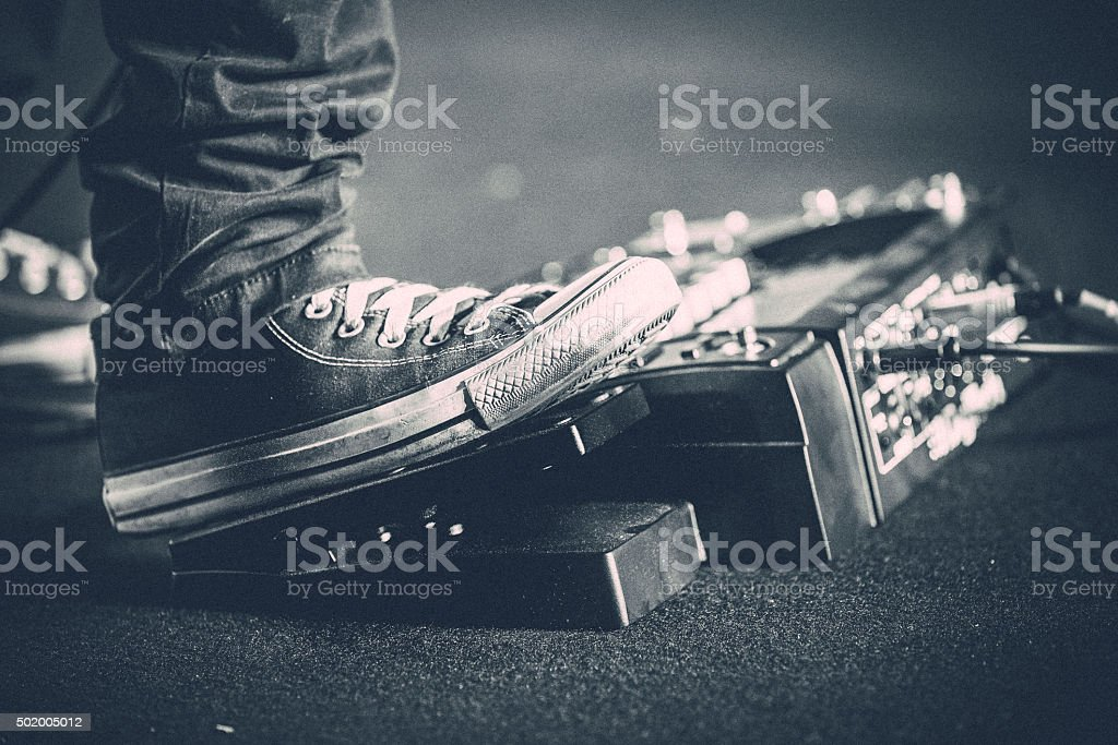 Solo Guitarist and Foot Paddle stock photo