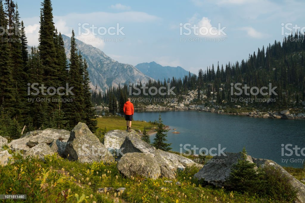 Solo hiking adventure in the mountains stock photo