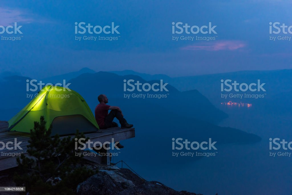 Solo hiking adventure in the mountains - Royalty-free Adult Stock Photo