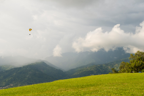 Small Paraglider And Vast Landscape In Bucaramanga Colombia Stock