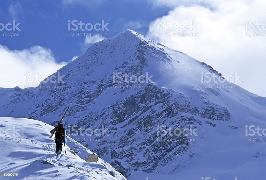 Solo skier hiking up mountain. royalty-free stock photo