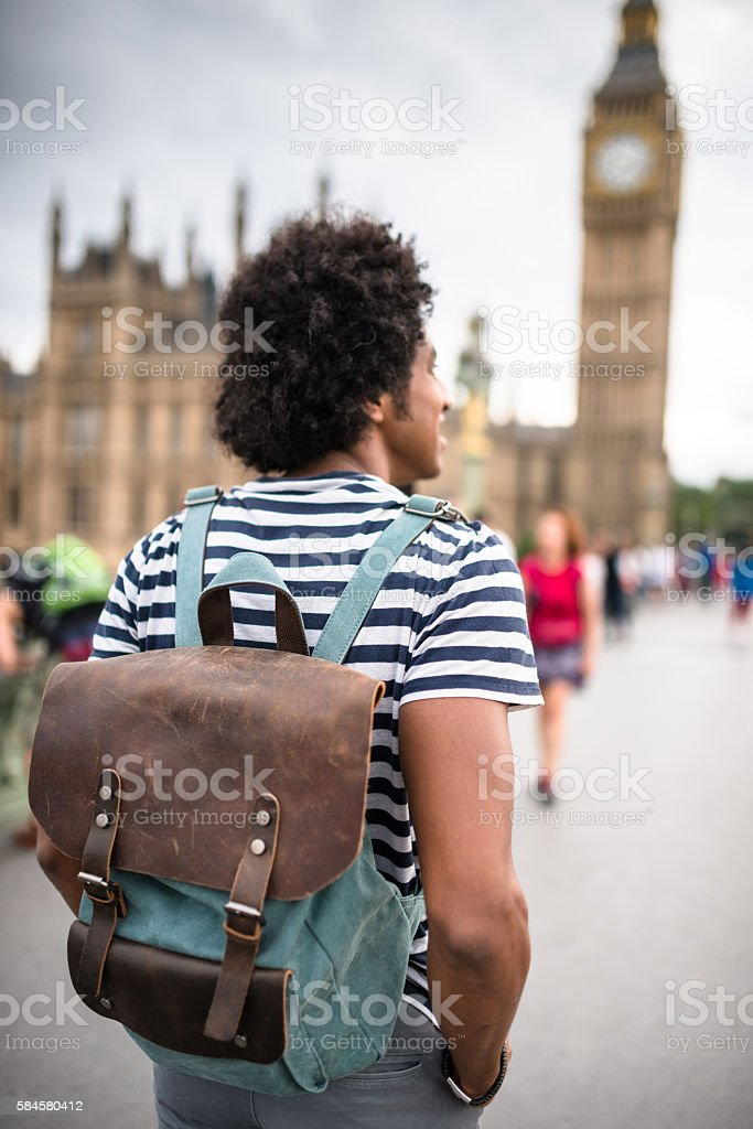 solo traveler in london observing the skyline stock photo