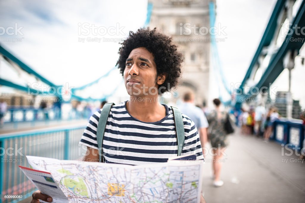 solo traveler in tower bridge area reading a map stock photo