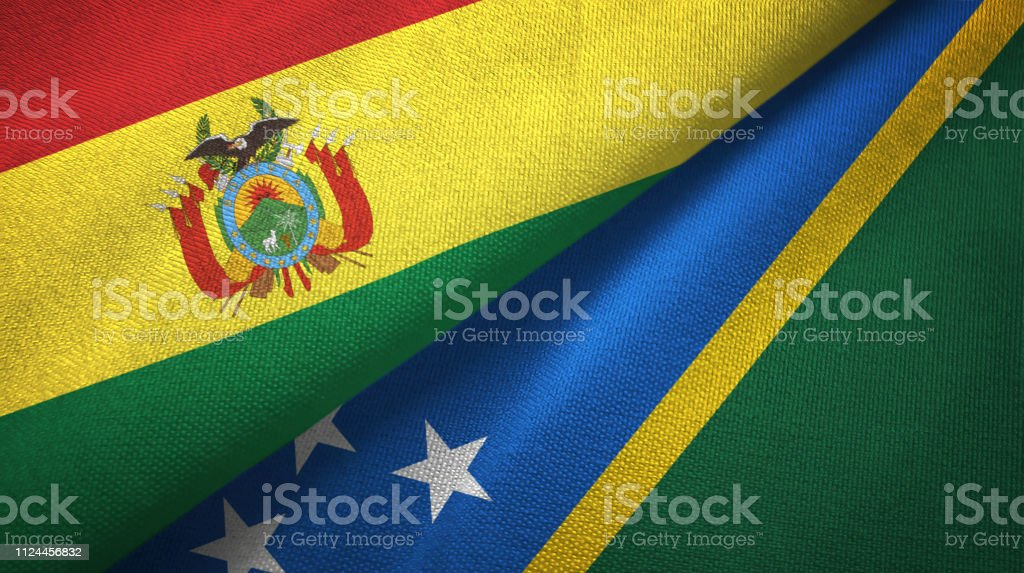 Solomon Islands and Bolivia two flags together textile cloth, fabric texture stock photo