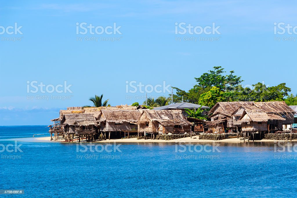 Solomon Islands Beach with Traditional Thatched Houses in Auki stock photo
