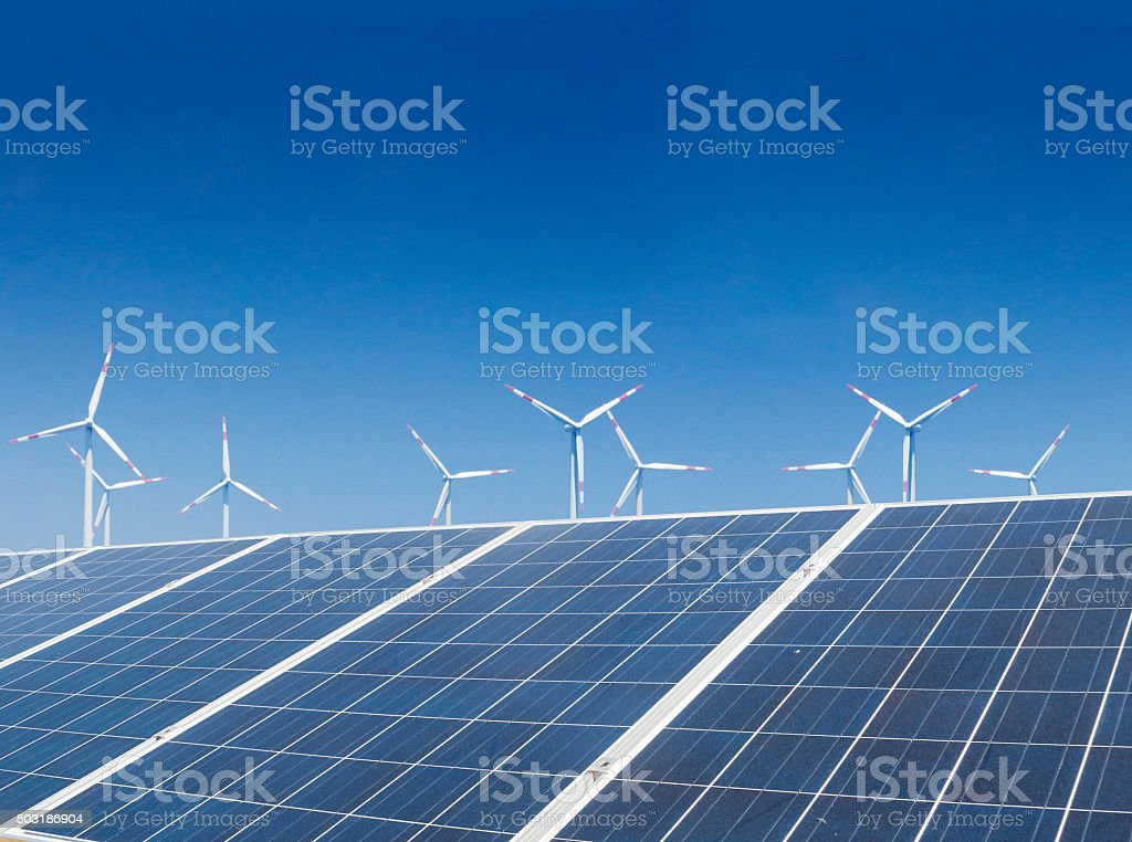 solor panel and wind power stock photo