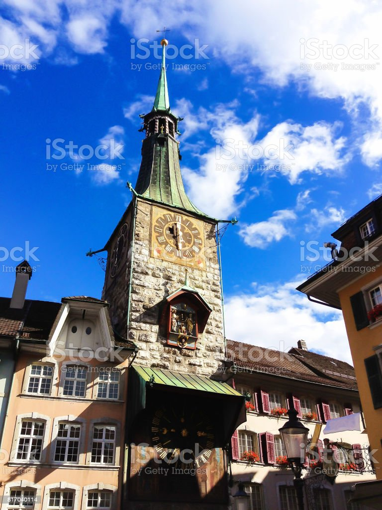 Solothurn clock tower - with storied clock and the oldest construction in the whole town, Solothurn, Switzerland, Europe. Solothurn is the capital of the Solothurn canton, Switzerland. It is located on the banks of Aare river and on the foot of the Weisse stock photo