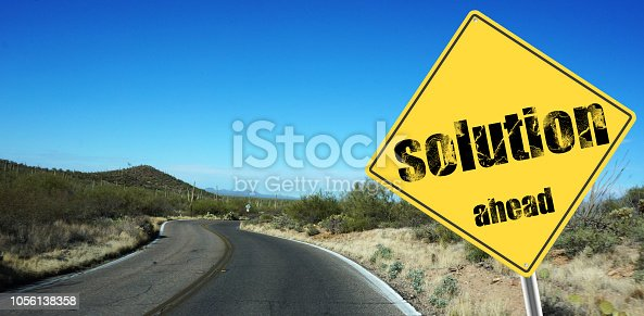 Solution ahead sign on a sky background and dessert road