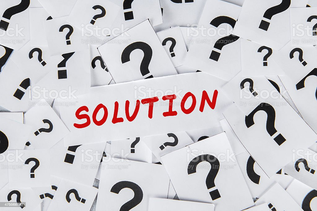 Solution and question marks stock photo