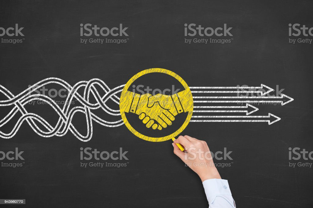 Solution Concept with Handshake on Chalkboard Background stock photo