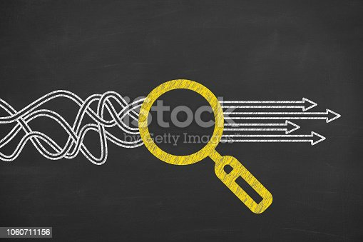 istock Solution Concept with Magnifying Glass on Chalkboard Background 1060711156