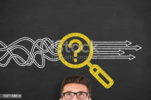istock Solution Concept with Magnifying Glass on Chalkboard Background 1097158818