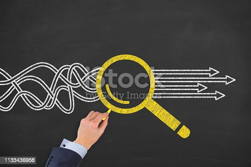 istock Solution Concept with Magnifying Glass on Chalkboard Background 1133436958