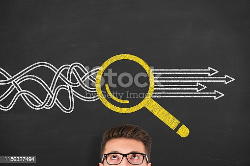 istock Solution Concept with Magnifying Glass on Chalkboard Background 1156327494