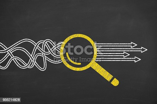 istock Solution Concept with Magnifying Glass on Chalkboard Background 935214828