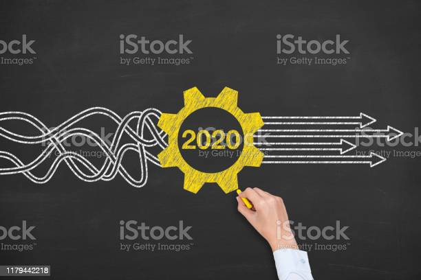 Solution Concepts New Year 2020 on Chalkboard Background