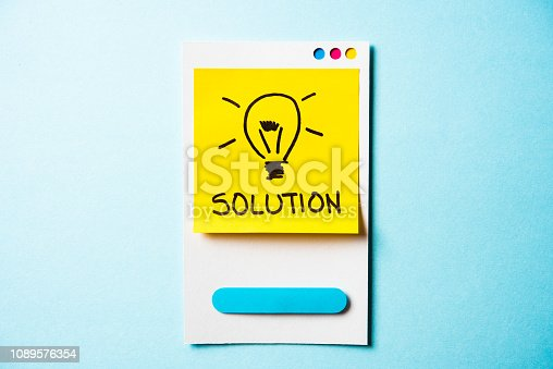 istock Solution, creativity and innovation concept. Paper card with illustration of lightbulb on post it note and blue background. 1089576354
