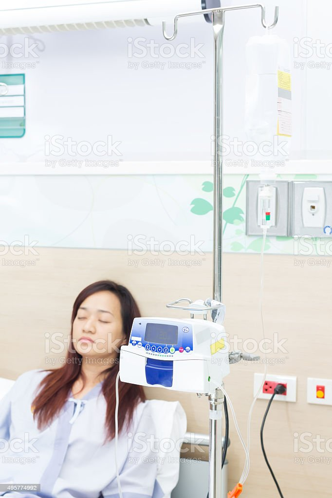 IV solution in asian female patient and IVS machine stock photo