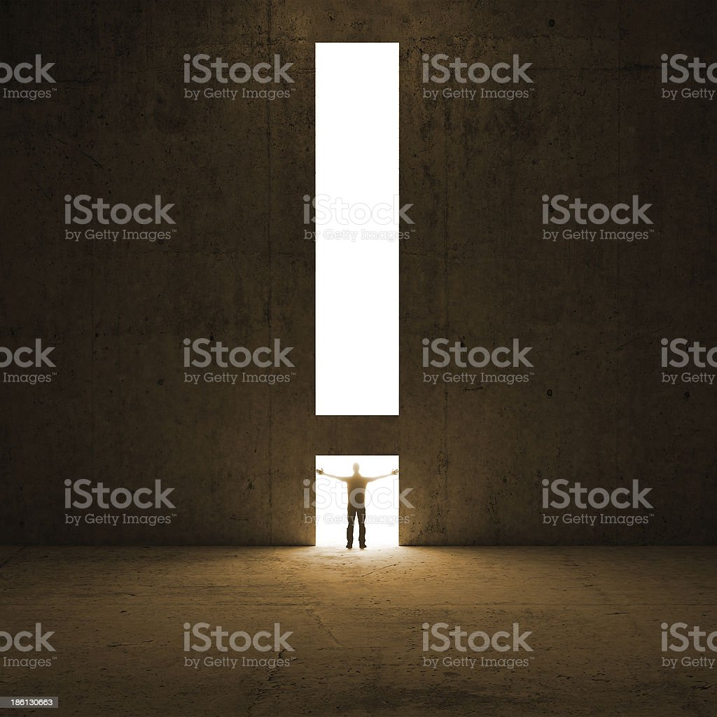 Solution metaphor. Man stands in the light stock photo