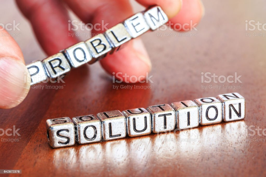 solution remove problem letters placed on a desk in precious wood stock photo