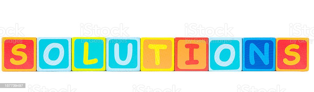 solutions word with toy bricks stock photo