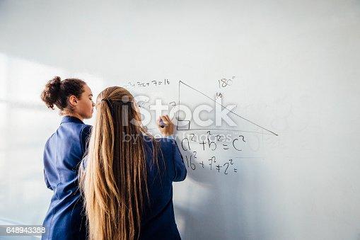 istock Solving a Mathematics Problem 648943388