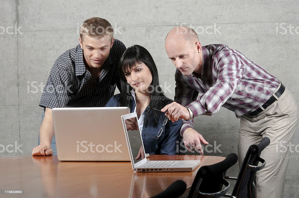 solving and analysing problems together in teamwork on a laptop royalty-free stock photo