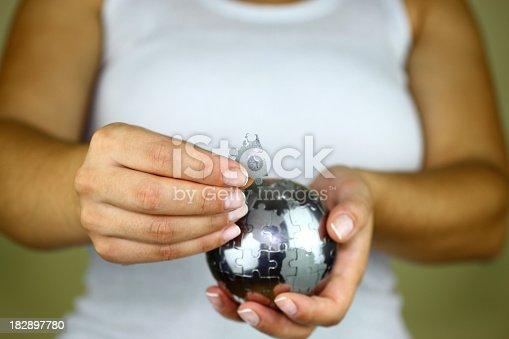 638813890istockphoto Solving globe puzzle 182897780