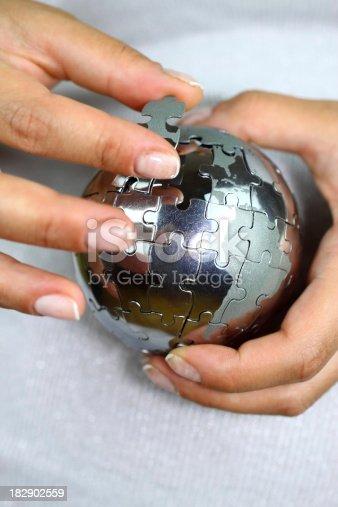 638813890istockphoto Solving globe puzzle 182902559
