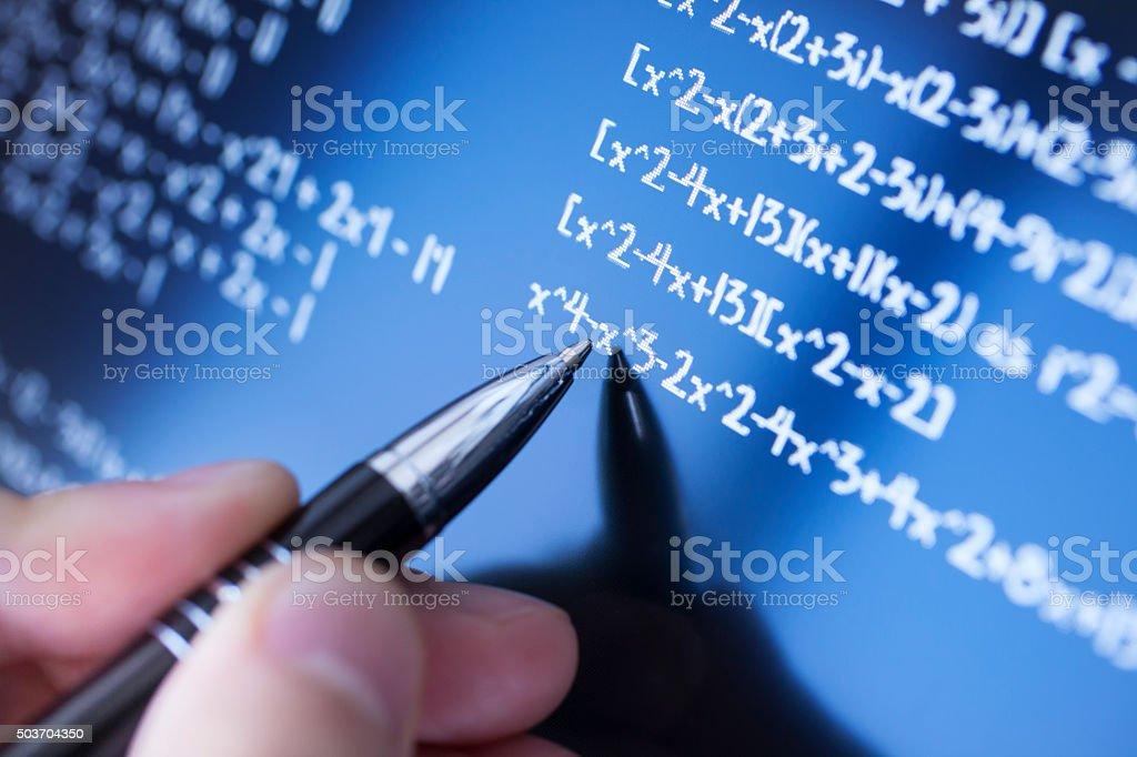 Solving math stock photo