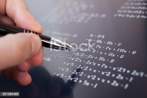 899619542 istock photo Solving math 531383483
