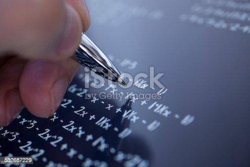 899619542 istock photo Solving math 532687229
