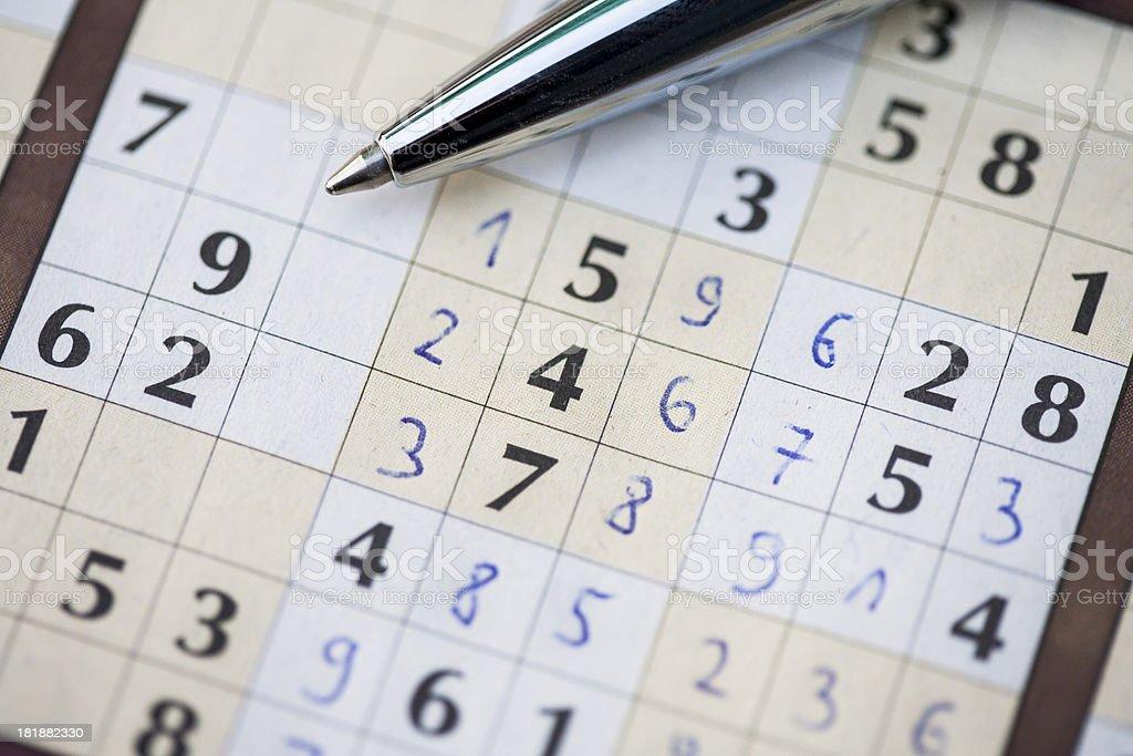 Solving sudoku royalty-free stock photo