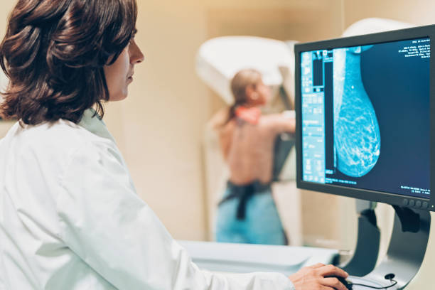Solving women's health issues Doctor and patient making a mammography medical x ray stock pictures, royalty-free photos & images