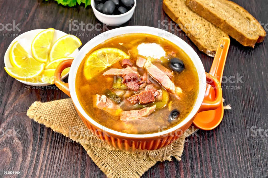 Solyanka with olives in bowl on sackcloth stock photo