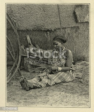 Vintage photograph of a Somali woman weaving a basket, Victorian 19th Century