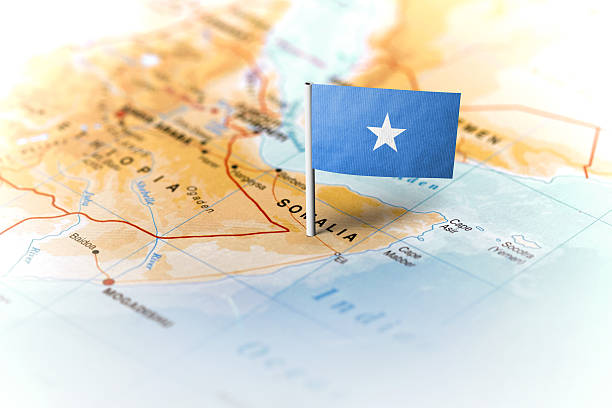 somalia pinned on the map with flag - somalia stock photos and pictures