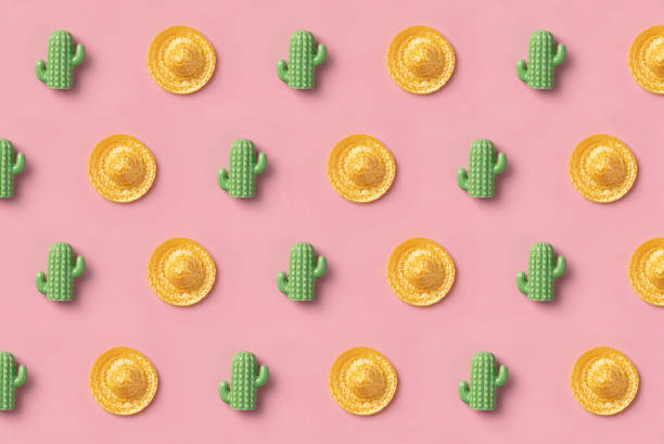 Sombrero and cactus pattern on pink background. Creative mexican stock photo