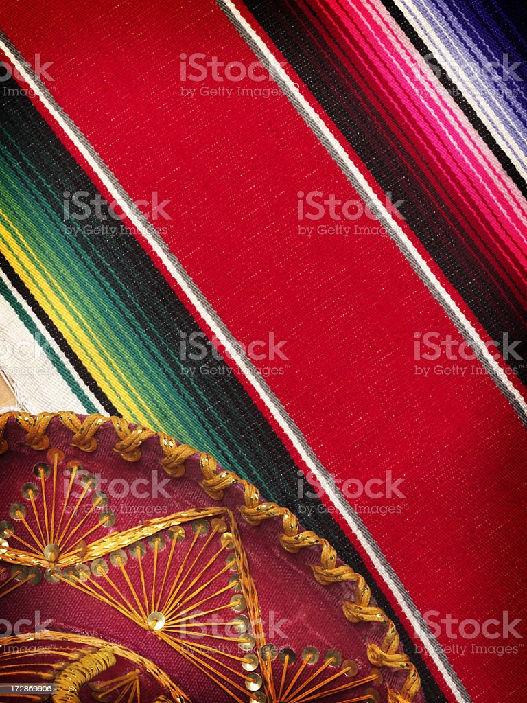 Sombrero on a festive Mexican blanket royalty-free stock photo